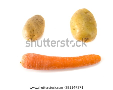 Isolated potato on the white background arranged in smile face shape - stock photo