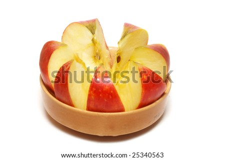 isolated pottery bowl filled with fresh delicious ripe apples