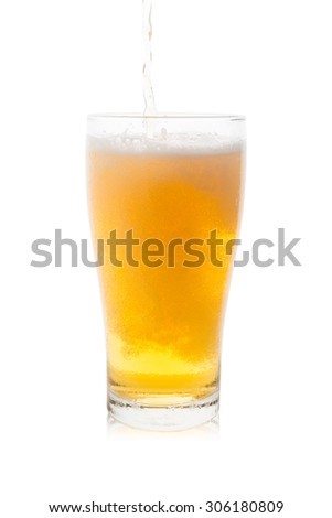 Isolated pouring beer into single glass of beer with bubbles