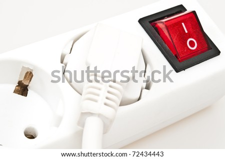 Isolated power outlet with red button - stock photo