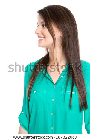 Isolated pretty young woman looking sideways in green blouse on white background. - stock photo