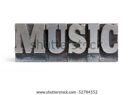 Isolated printers blocks letters forming the word music. - stock photo