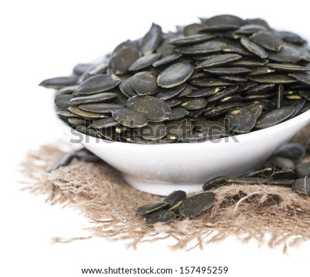Isolated Pumpkin Seeds (on white background) - stock photo