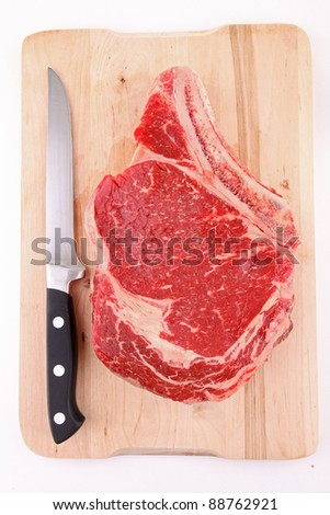 isolated raw rib steak - stock photo