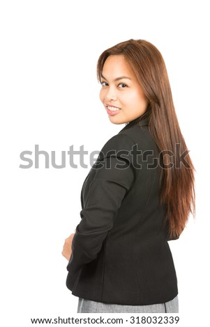Isolated rear view of kind Asian businesswoman professional in black business jacket with charming smile looking back over her shoulder at camera. Thai national of Chinese origin. Vertical half - stock photo