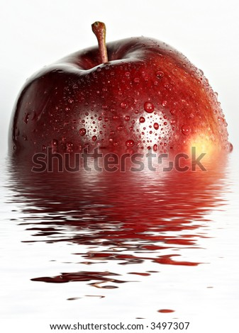 Isolated Red apple in water - with water drops - stock photo