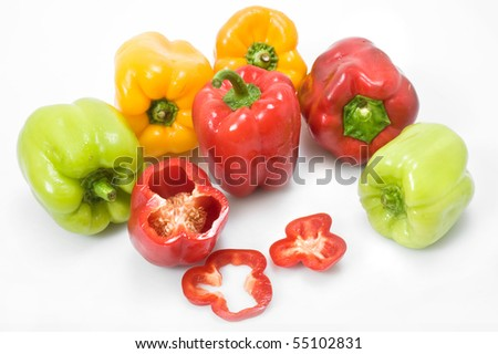isolated red ,green and yellow pepers