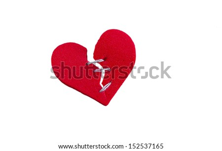 isolated red heart, broken with threaded stitches - stock photo