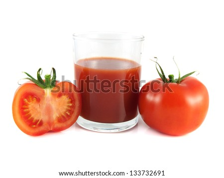 Isolated red ripe tomato, slice with glass of tomato juice on a white background. Healthy vegetable.