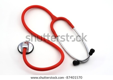 Isolated red stethoscope - stock photo