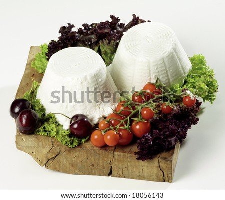 """isolated """"ricotta"""" cheese on cutting board - stock photo"""