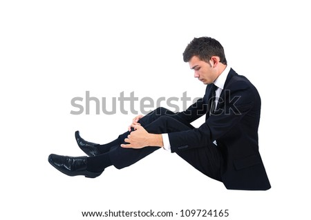 Isolated sad business man sitting down