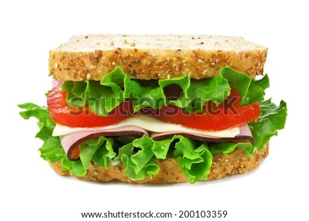 Isolated sandwich on a whole grain bread with ham, tomato, lettuce and cheese     - stock photo