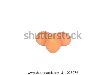 Isolated scene of three eggs with white background - stock photo