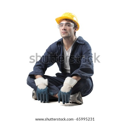 Isolated seated worker - stock photo
