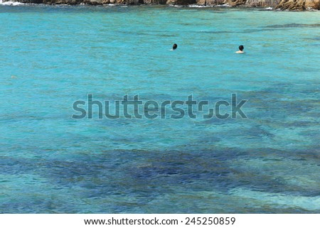 isolated seawater near the shore turquoise-blue color on a sunny day - stock photo
