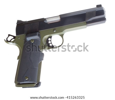 Isolated semi automatic handgun that has a green metal frame