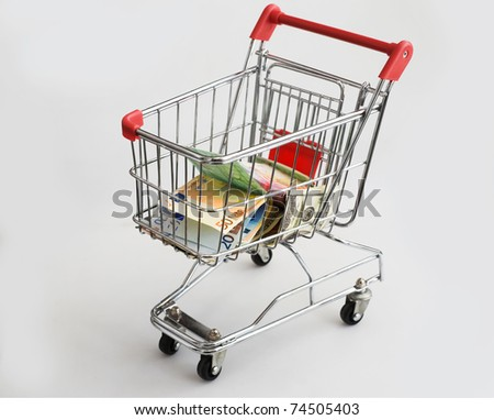 isolated shopping cart with money
