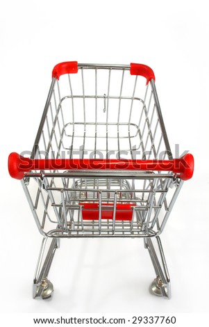 Isolated shopping trolley over white - stock photo