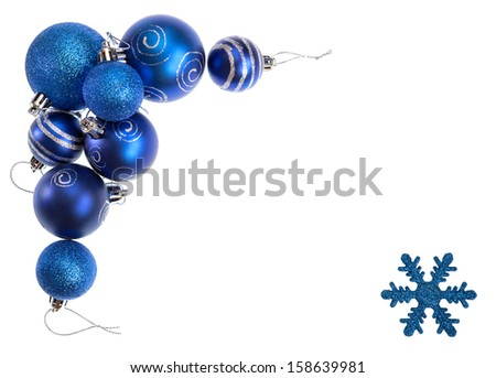 Isolated shot from a Christmas decorative frame consisting of blue baubles in different sizes and designs plus a single blue snowflake. - stock photo