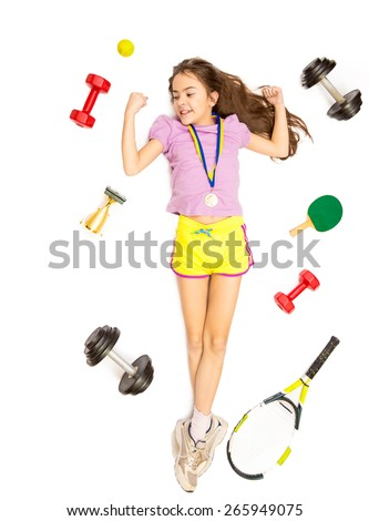 Isolated shot from high point of active girl lying on floor with different sport equipment - stock photo