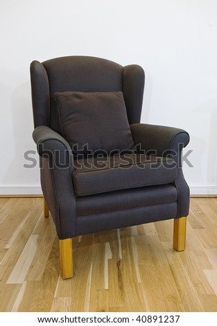 isolated shot of a comfortable fabric armchair - stock photo