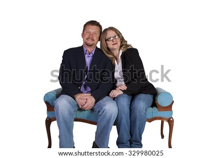 Isolated shot of a couple sitting on an antique chair - white background - stock photo