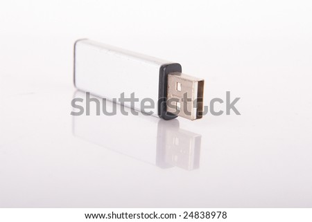 Isolated shot of a silver USB stick. The stick is mirrored. Lot of copyspace.