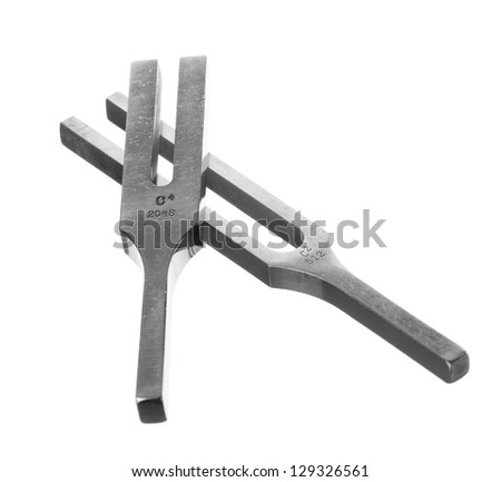 Isolated shot of 2 old tuning forks