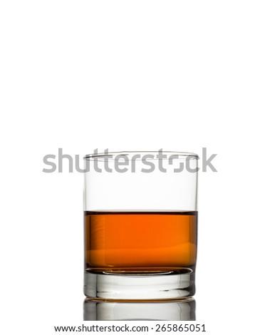 Isolated shot of whiskey with splash on white background - stock photo