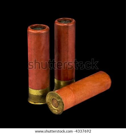 isolated shotgun shells on black  background - stock photo