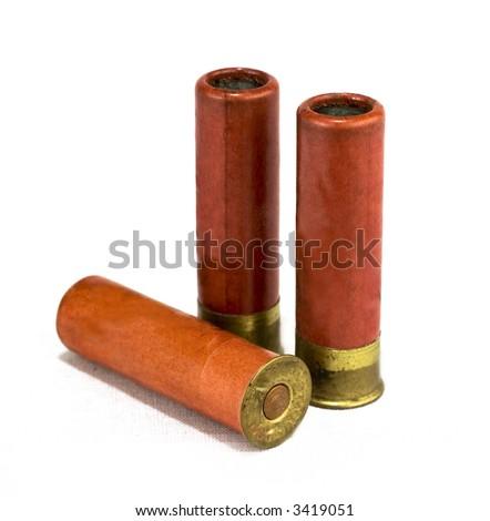 isolated shotgun shells on white background - stock photo