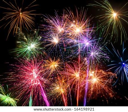 Isolated shots of fireworks blasts on black background - stock photo