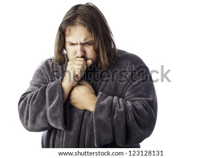 isolated sick man bundled up in a robe coughing
