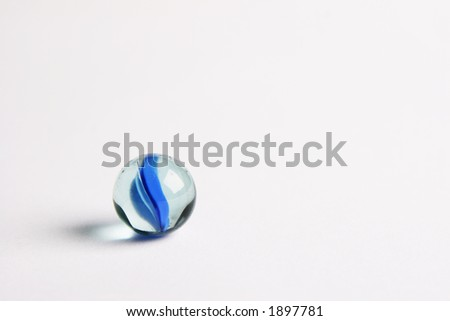 Isolated single marble on white background - stock photo