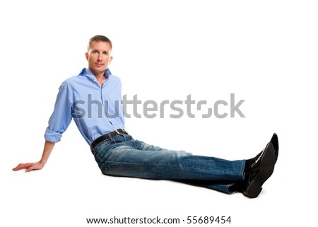 isolated sitting on the floor man over white - stock photo