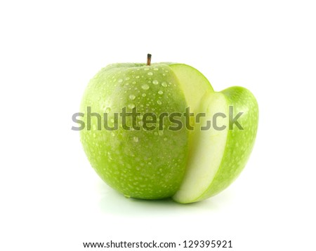 Isolated sliced green apple with water drops (white background). Fresh diet fruit. Healthy fruit with vitamins. - stock photo