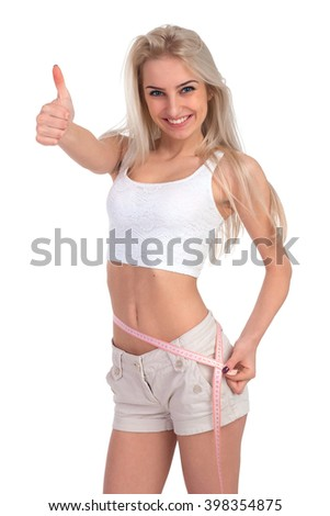 Isolated slim girl with centimeter on a white background