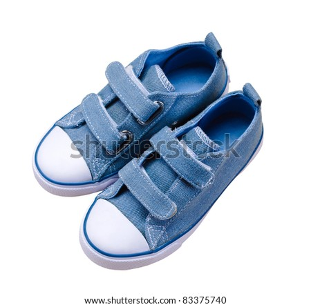 isolated small blue sport shoes for children - stock photo