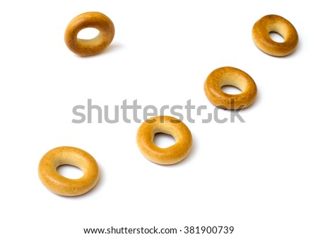 Isolated small rounds of dry bagels on white background - stock photo