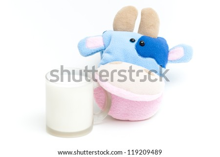 Isolated soft hand puppet cow with glass of milk - stock photo