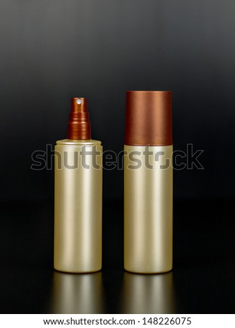 Isolated spray bottle with and wthout cap - stock photo