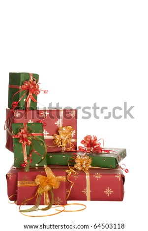 Isolated stack of christmas presents in red and green - stock photo
