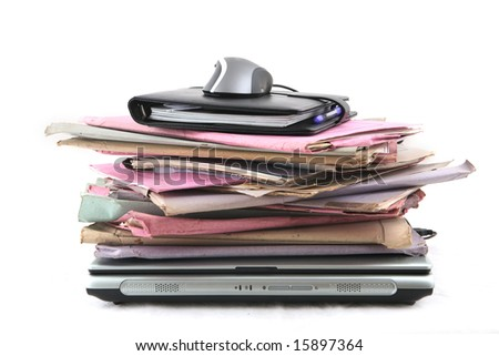 Isolated stack of folder with laptop computer and a mouse shot over white background - stock photo