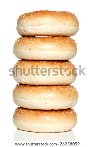 Isolated stack of fresh sesame seed bagels
