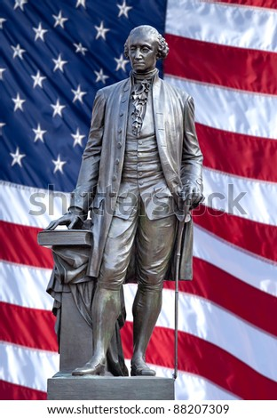 Isolated statue of George Washington, Independence Hall, Philadelphia, PA. The United States flag is in background.