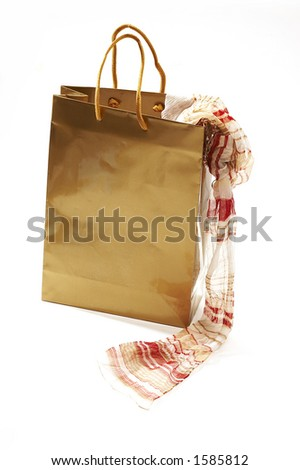 isolated still life: golden paper bag with lightweight neck-piece - stock photo