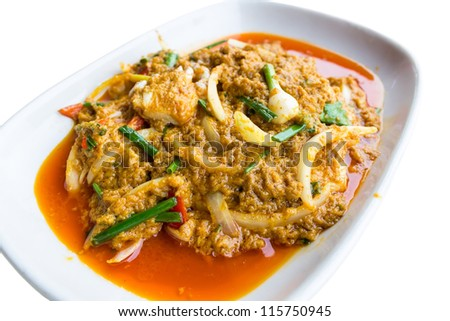 Isolated stir-fried crab with Garlic, Pepper, Curry Powder on plate. - stock photo