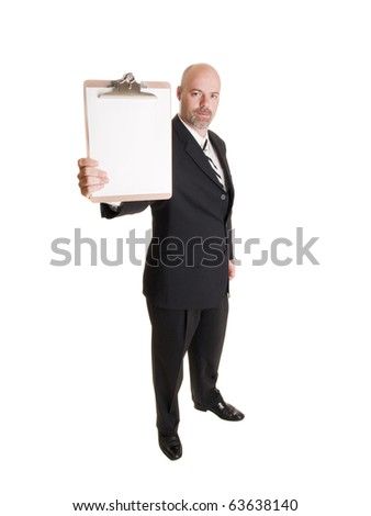 Isolated stock photo of a caucasian businessman looking at the camera while holding out a blank page on a clipboard. - stock photo