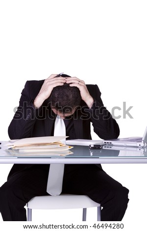 Isolated Stressed Businessman At His Desk  - White Background - stock photo